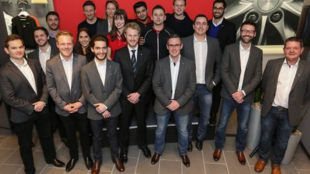 The Tesla team including the Knutsford Store team - sales advisors Steve Edge (front row furthest ri