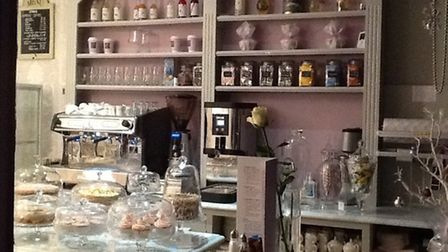 The enticing counter bedecked with glass cake stands