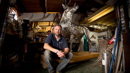 Michael Turner with his stag sculpture in his studio at Setters Farm