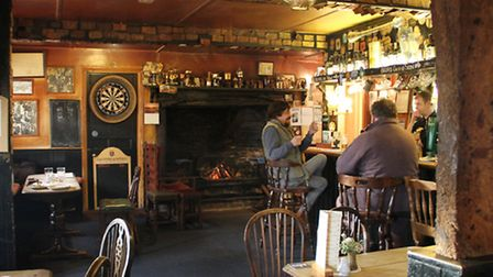 'The warmth of the fire coming from a classically over indulgent inglenook draws me in towards an en