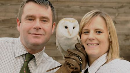 Clare and her husband Phil with 'Henry', a three-year-old Barn Owl