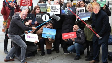 Activists impersonating Dominic Cummings and Boris Johnson take part in a 'whack a mole' photo call