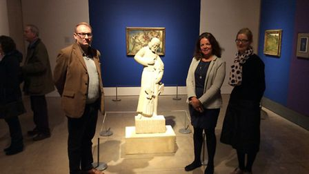 The 'still small voice' team beside Eric Gill's sculpture of Christ