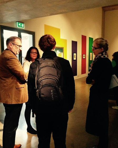 Joe meeting the team behind the exhibition, including Angus Pryor, Head of Fine Art & Design at the