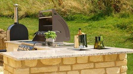 An outdoor kitchen can provide a great social area for family and friends to gather
