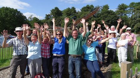 Volunteers celebrate another day's work on the mossland at Delamere. Picture by Heather Hulse