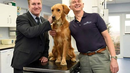 NatWest's Steve Moore with Dr Martin Whitehead and Trevor, Martin's working golden retriever.