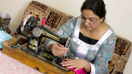 Magdalein Javed at work in her Rawlpindi home