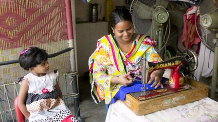 Nazia Arifs daughter watches on as she works on a scarf