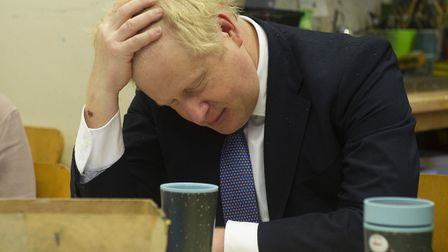 Prime Minister Boris Johnson at a centre for homelessness. Photograph: Tim Clarke/DailyExpress/PA Wi