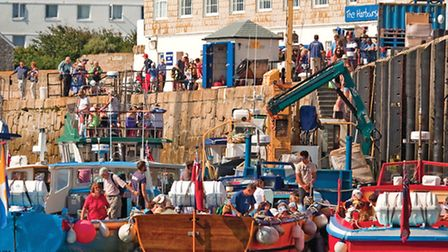 The busy harbourside at St Mary's. Step aboard a ferry here and explore each and every one of the is