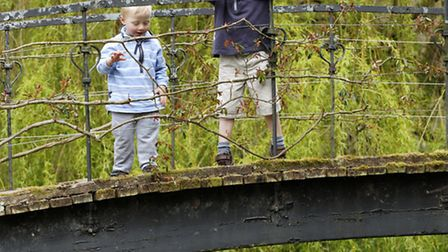 Children playing Pooh sticks on a bridge over the River Test at Mottisfont ©National Trust Images/Me