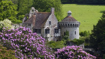 The ruins of the fourteenth-century moated Scotney Castle, Lamberhurst, Kent, set amidst beautiful g