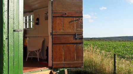 A shepherd's hut fits perfectly into the rural landscape | Photo: Cotswolds Shepherds Huts