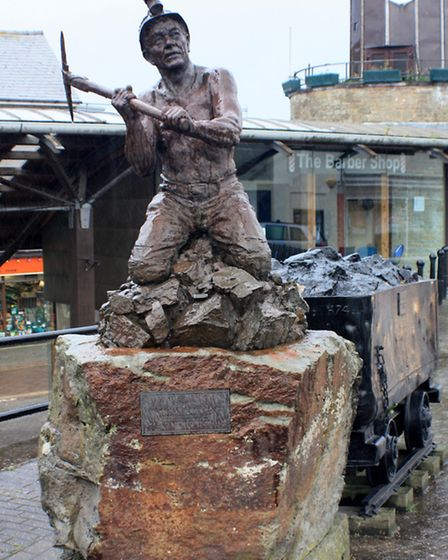 Symbolising the industry, statue of Dave Harvey on the Triangle, Cinderford