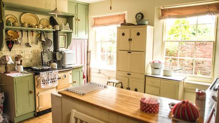 Anna's homely kitchen. She has hand-made the details, including the blinds and curtains