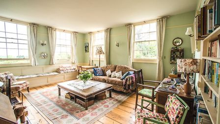 The sitting room, where Anna and John spend most of their time. There is a sewing machine in the cor