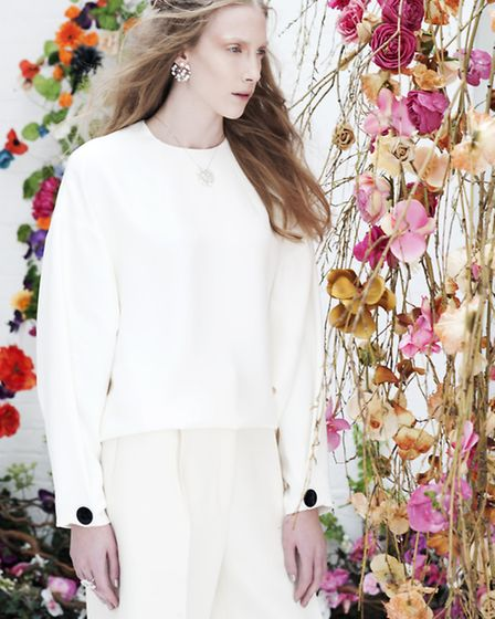 Celine £1150 culottes; Celine white top with black button detail £1900; earrings Asclepias collectio