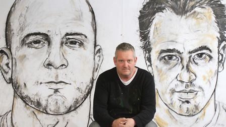 Artist Russell Haines with his portraits of Gloucester Rugby stars