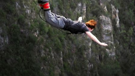 Me, falling through the air during my bungee off Bloukrans Bridge | Photo courtesy of Face Adrenalin