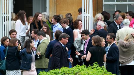 Guests enjoying drinks on the terrace at Kitebrook House