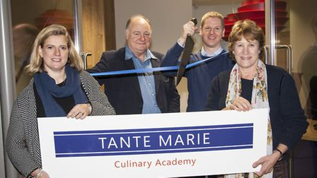 Andrew cuts the ribbon with business partners (L-R) Lyndy Redding, Hugh and Marcella O''Donovan