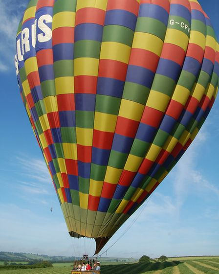 Waiting in a hay field for permission from the landowner to deflate the balloon