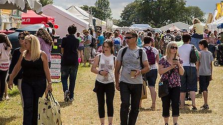 People browse the market at the Cotswold Show and Food Festival