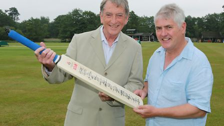 Commentator for the cricket, Goden Burns, and Nick Hancock with a cricket bat signed by the Lancashi