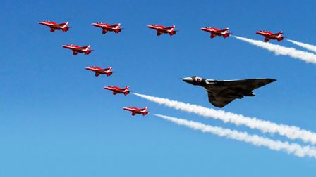 The world's only operational Avro Vulcan, XH558 flying over RAF Fairford with The Red Arrows marking