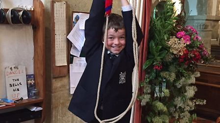 Ethan Barter in action ringing the bells at St Giles