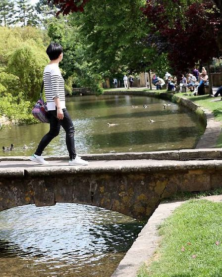 Corssing the tiny bridges is part of the Bourton experience / Credit: Lynn Ede