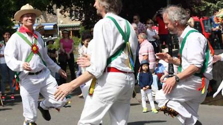 The Morris dancers throw shapes navigating around a tiny, bemused observer / Credit: Lynn Ede