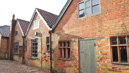 The pottery is housed in a lovely old red-brick building (Photo Farnham Pottery)