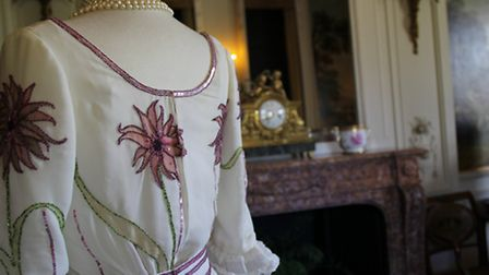 The elaborate dress is made of pure silk and is adorned with 5,000 sequins (Photo National Trust)