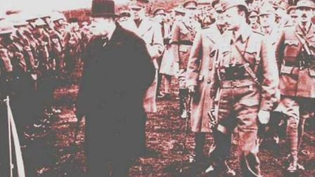We believe that Hignett is to the immediate right of Churchill in this photograph, inspecting his tr