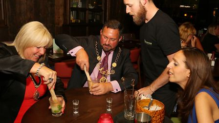 Lady Mayoress of Chester Deb Deynem and Lord Mayor of Chester Cllr Hugo Deynem learn how to make a c
