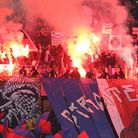 The ultras fans of Paris St-Germain unfurl banners and ignite flares during a Ligue 1 clash with Nic