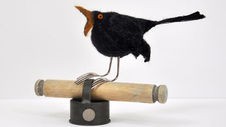 Here''s a chirpy black bird in needle-felted blanket with vintage child's rolling pin, pastry cutter