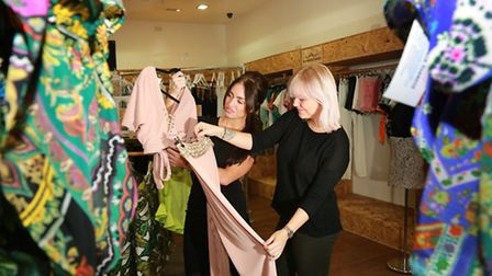 Studying fashion....Chelsea Slater (blond hair), Marketing Manager, and customer, Amy Brownley at R