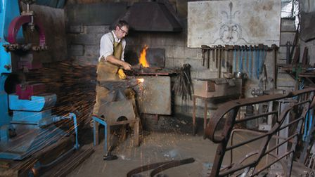 Oliver Russell spends his days shaping metal (Photo: Philip Traill)