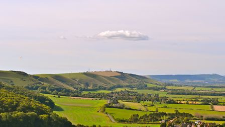 Views west along the South Downs over the villages of Poynings and, in the distance, Fulking