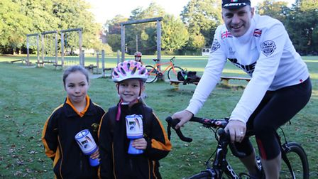 Chloe Lowndes and Charlotte Hunt with Jon Hunt