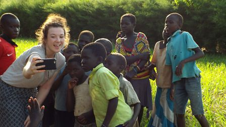 Vicky Kendal taking a selfie with some Congolese pupils