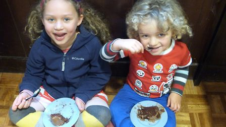Children enjoying the home baked chocolate cake