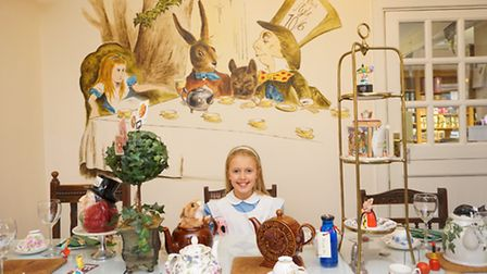 Alice in Wonderland, aka Lucy Wilkinson, 11, enjoys the Mad Hatter's Tea Party at Davenports