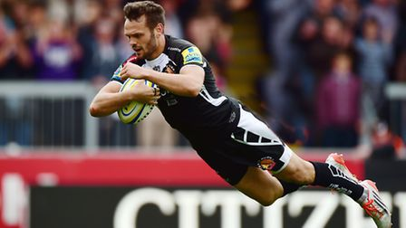 Phil Dollman of Exeter Chiefs goes over for a try