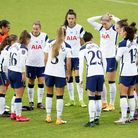 Tottenham players forming a huddle before a WSL match
