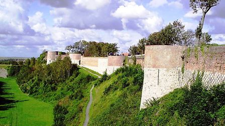The ramparts dating back to the 16th century encircle the upper town