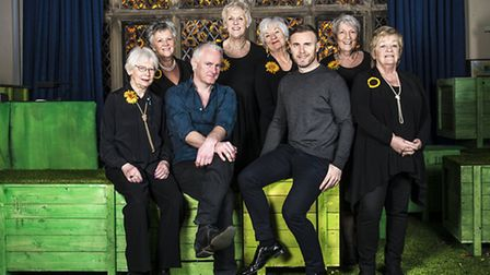 Gary Barlow and Tim Firth with the original calendar girls on set at The Lowry Salford | The Girls